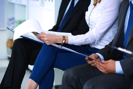 job interview: Group of business people sitting on chair in office Stock Photo