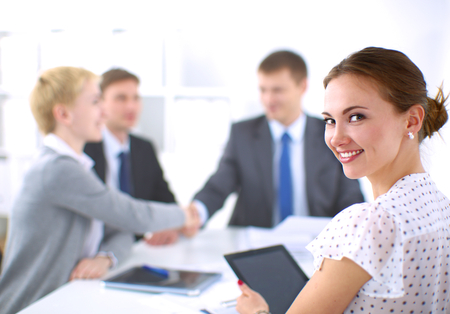Business people shaking hands, finishing up a meeting Stock Photo - 40510357