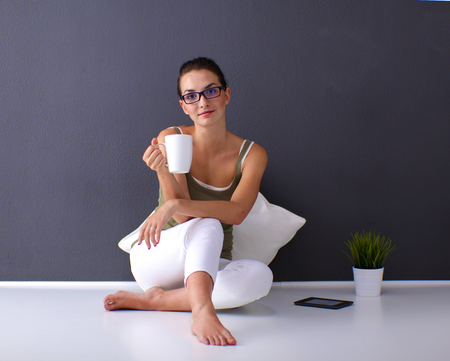 caucasian girl: Attractive caucasian girl sitting on floor