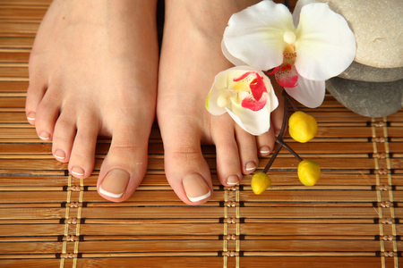 gentile: Care for beautiful woman legs with flower
