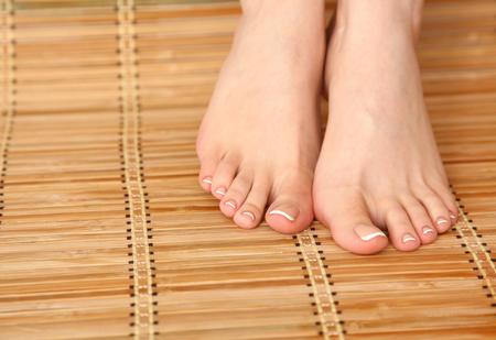 healthcare and beauty: Care for beautiful woman legs on the bamboo floor .