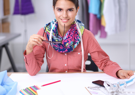 business fashion: Modern young fashion designer working at studio.