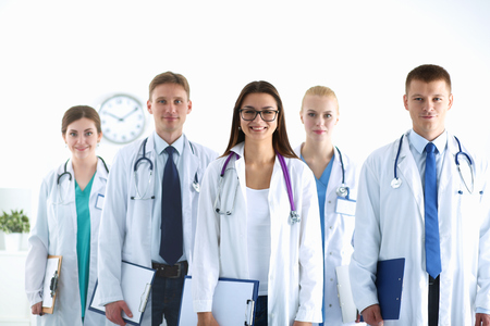 standing together: Portrait of group of smiling hospital colleagues standing together . Stock Photo