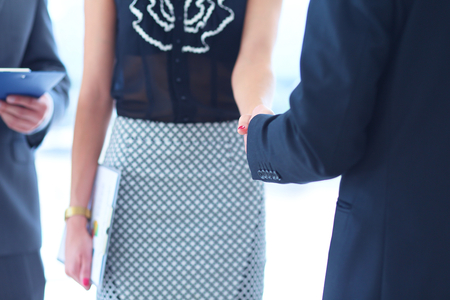 Businesswoman Shaking Hands In Office Stock Photo