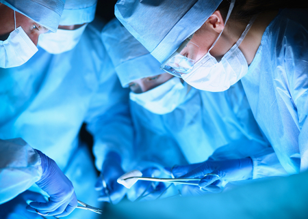 operation room: Young surgery team in the operating room . Stock Photo