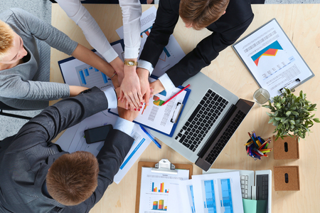 Business team with hands together - teamwork concepts, isolated