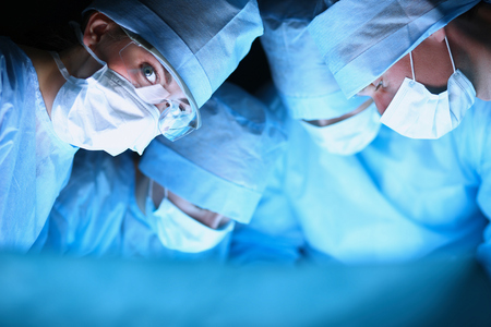 Young surgery team in the operating room . Banque d'images