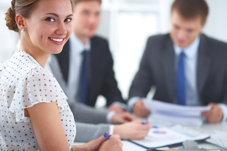 female business: Business handshake. Business people shaking hands, finishing up a meeting Stock Photo