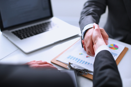 Business handshake. Business people shaking hands, finishing up a meeting Stock Photo