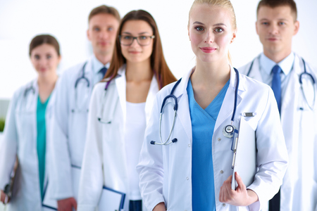 Portrait of group of smiling hospital colleagues standing together . Stock Photo