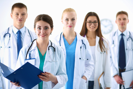 women working: Portrait of group of smiling hospital colleagues standing together . Stock Photo