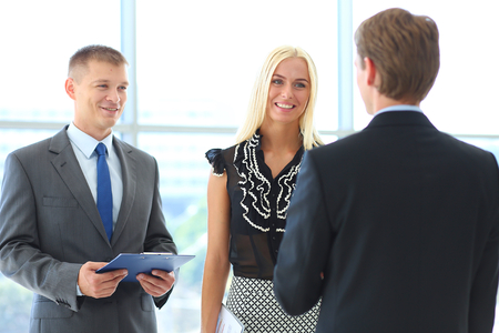 people in office: Businesswoman Shaking Hands In Office Stock Photo