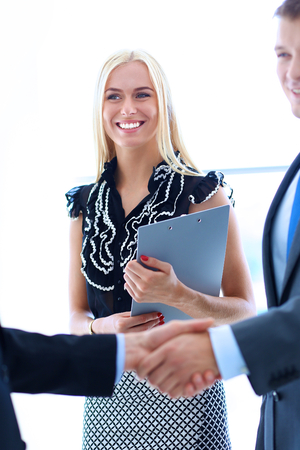 mature business man: Business people shaking hands after meeting .