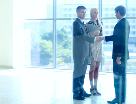 business hand shake: Business people shaking hands after meeting .