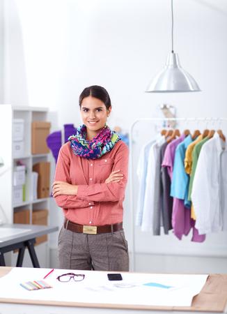 Young fashion designer working at studio .