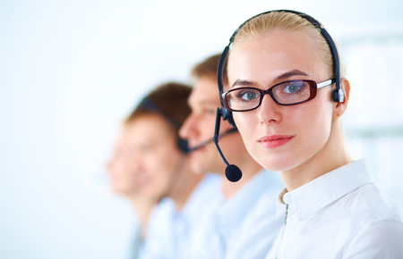 tech support: Attractive positive young businesspeople and colleagues in a call center office. Stock Photo