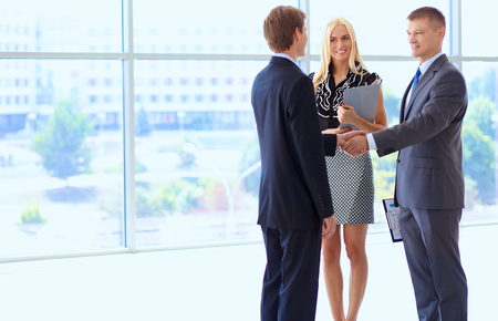 business manager: Business people shaking hands after meeting .