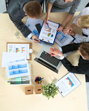 Business people sitting and discussing at business meeting, in office. Stock Photo - 44699058