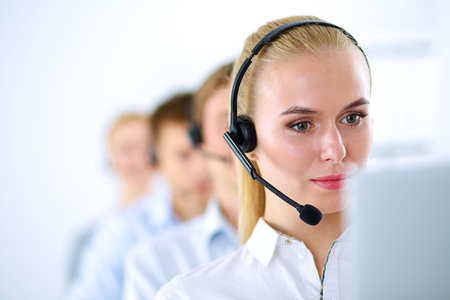 call girl: Attractive positive young businesspeople and colleagues in a call center office. Stock Photo