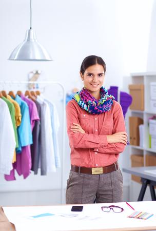 designer: Young fashion designer working at studio .
