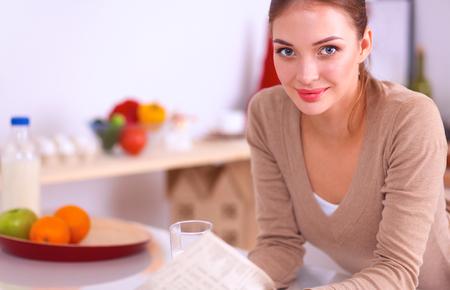 Happy young woman having healthy breakfast in kitchen .