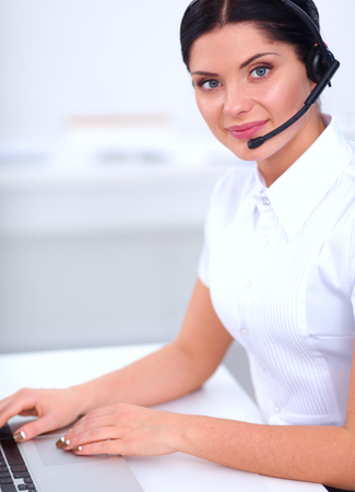 call centre girl: portrait of a customer service agent sitting at office Stock Photo