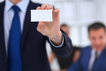 endorsing: Close-up of a businessman holding a blank business card