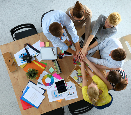 teamwork together: Business team with hands together - teamwork concepts, isolated