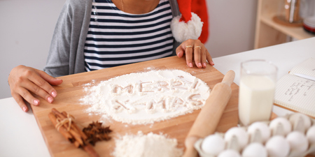 woman baking: An attractive woman baking in the kitchen Stock Photo