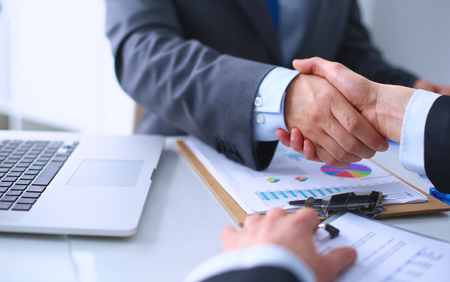 female lawyer: Business handshake. Business people shaking hands, finishing up a meeting Stock Photo
