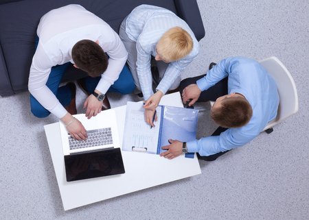 unanimous: Business people s.haking hands, finishing up a meeting