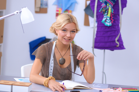 designer: Modern young fashion designer working at studio.isolated