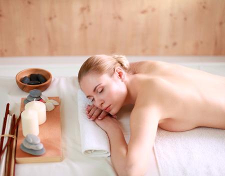 salon and spa: Young woman getting spa massage, lying on spa salon Stock Photo