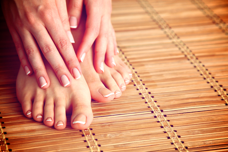 pedicure: Care for beautiful woman legs on the floor.