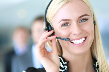 service broker: Portrait of  support phone operator with the headset . Stock Photo