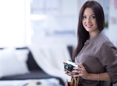 proffessional: Pretty woman is a proffessional photographer with camera