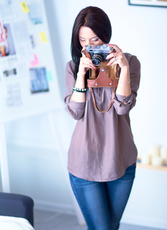 proffessional: Woman is a proffessional photographer with camera.