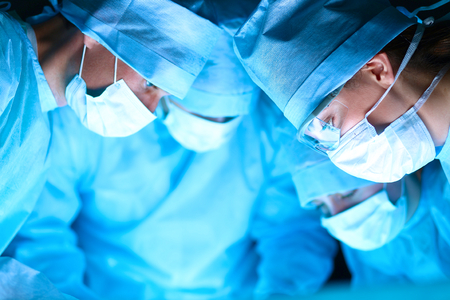 surgery room: Young surgery team in the operating room . Stock Photo