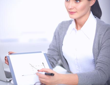 extending: Beautiful businesswoman handing over paperwork extending in office Stock Photo