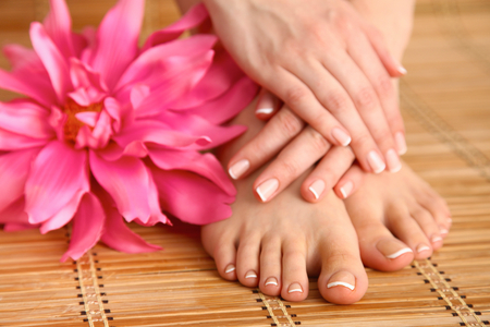 salon background: Care for beautiful woman legs with flower .