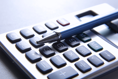 background image: pen and calculator on business paper Stock Photo