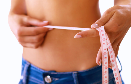 beautiful navel women: Slim waist with a tape measure around it Stock Photo