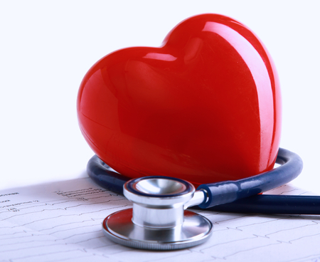 disease: Stethoscope and heart on the diagramm
