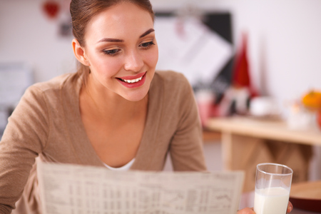 ?oung woman having healthy breakfast in kitchen Stock Photo