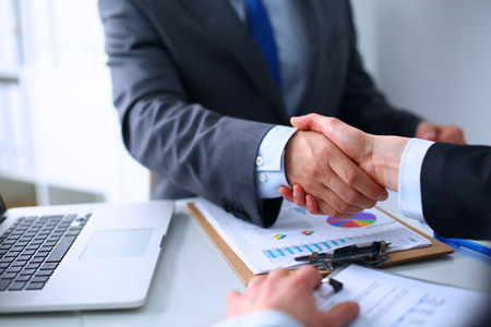 strategy meeting: Business handshake. Business people shaking hands, finishing up a meeting Stock Photo