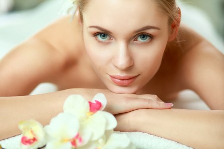 beauty woman: Beautiful young woman getting spa massage, lying on salon. Stock Photo