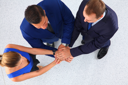 joining hands: Business team joining hands together.