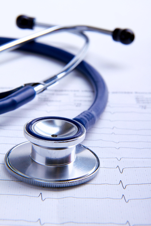 medical clinic: Stethoscope on electrocardiogram