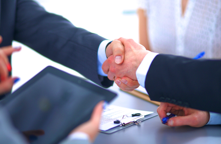 male       hand: Business handshake. Business people shaking hands, finishing up a meeting Stock Photo