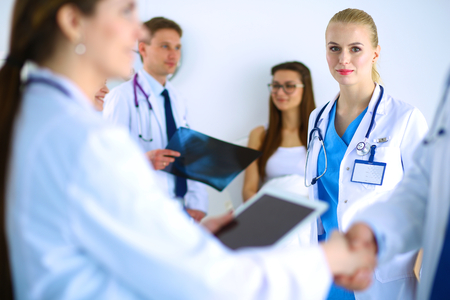 handshaking: Young medical people handshaking at office